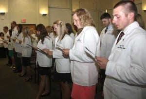 The 2016 Class of Physician Assistants recite the professional oath.